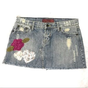 Size 28 distressed patch embellished mini skirt